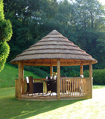 3.5 metre thatched roof gazebo in sunny cove of garden