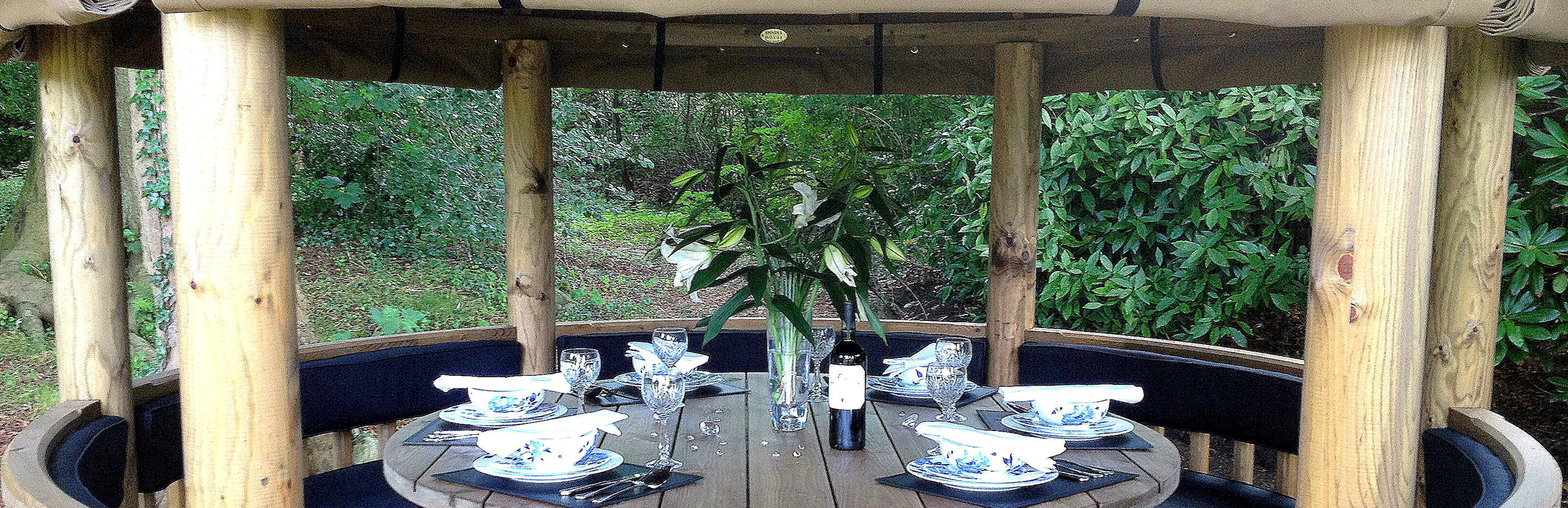Close up of 3 metre gazebo inside with table set for dinner