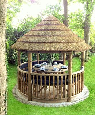 3 metre thatched gazebo with table set for dinner