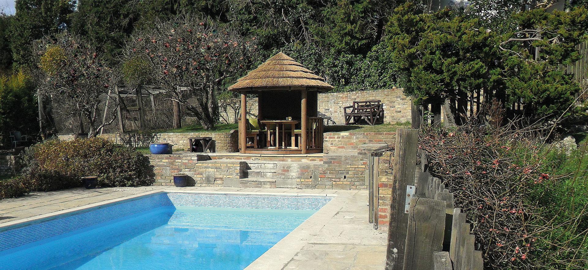 2.5 metre gazebo overlooking outdoor swimming pool