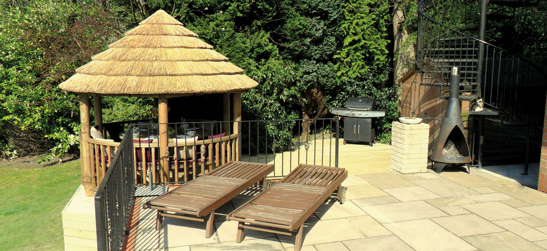 3 metre thatched roof gazebo on decking