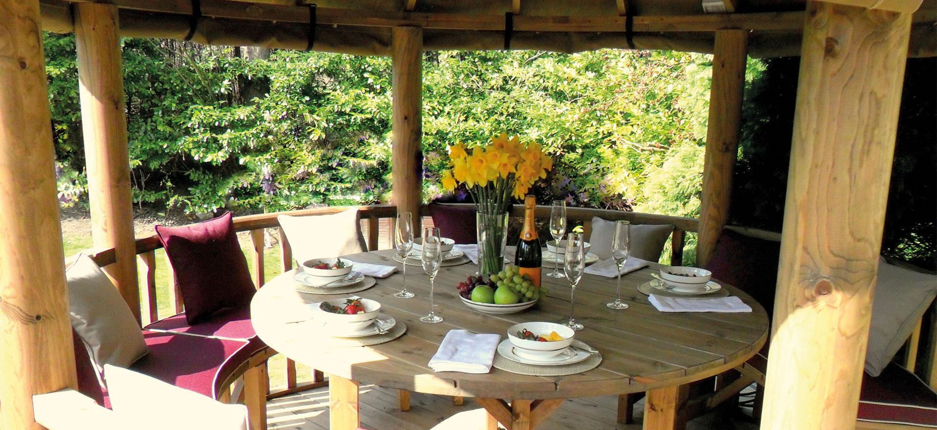 looking inside 3 metre gazebo with table set set for dinner
