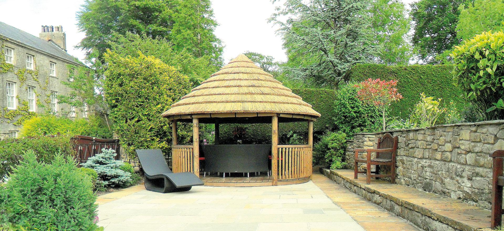 4 metre luxury gazebo at the end of a garden patio