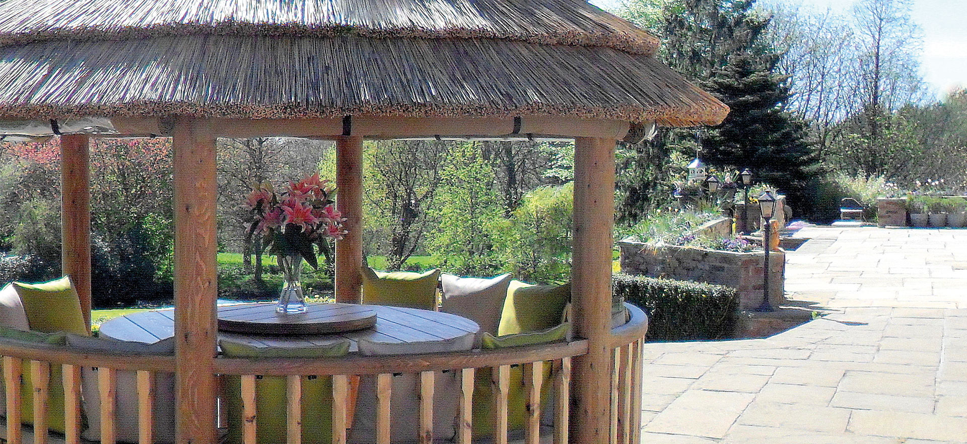 close up image of 3 metre thatched gazebo on a patio