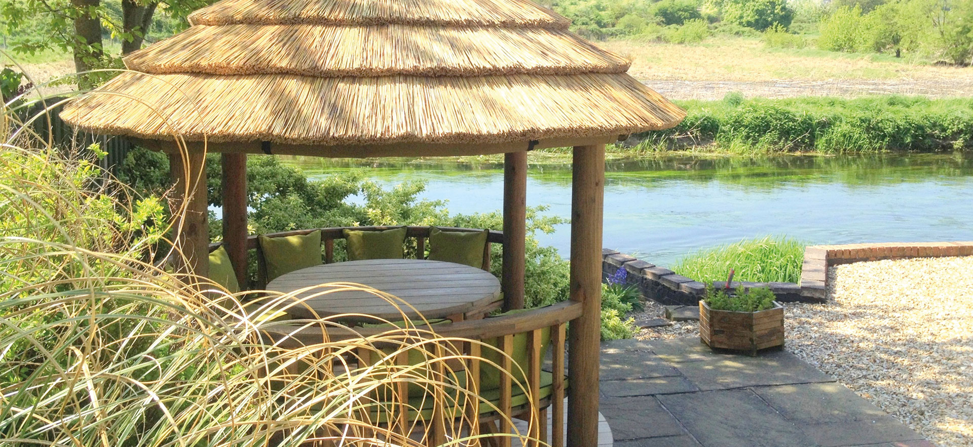 2.5 metre thatched gazebo overlooking waterfront