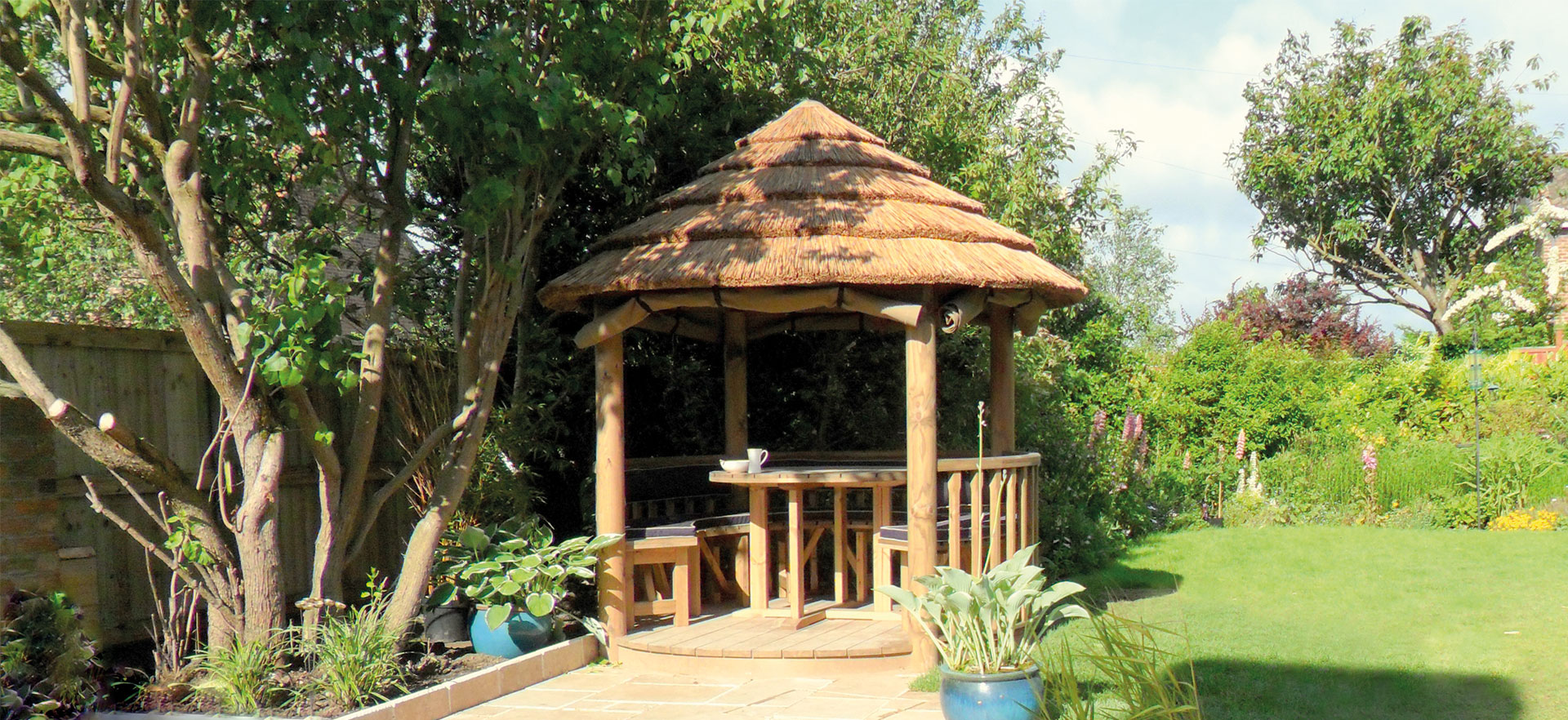 2.5 metre gazebo in the shade of trees in garden
