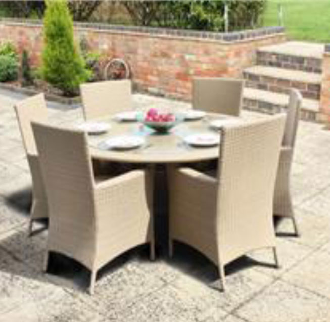 Cream rattan table with 6 chairs on patio