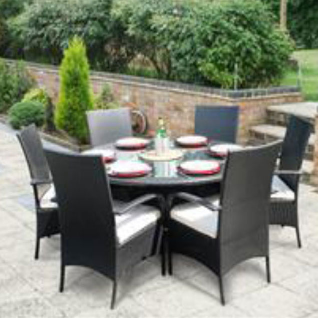 Black rattan table with 6 chairs on patio