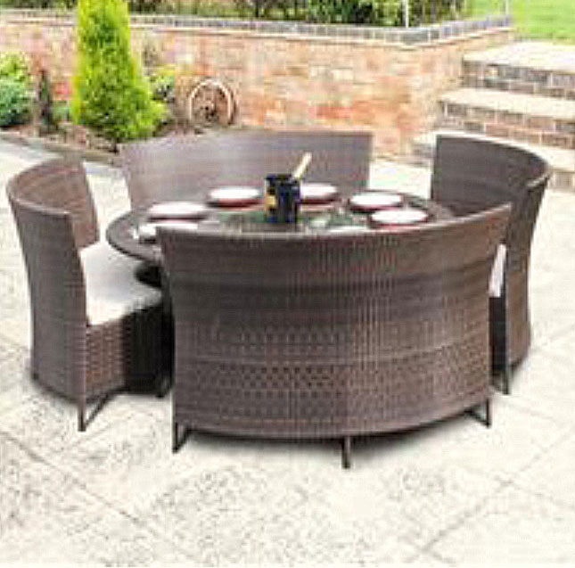 Brown rattan table with benches on patio