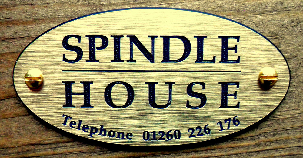 Close up of Spindle House sign with phone number