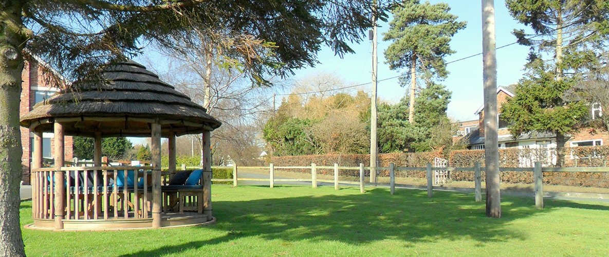 3 metre gazebo in open garden next to a road